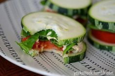 Totally Raw Zucchini sandwiches: Two slices of zucchini, spread some humus, one slice of tomato, your choice of parsley, lettuce or cilantro, dash of pepper. Enjoy.