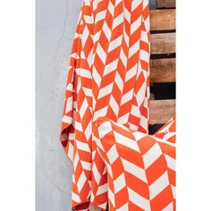 This beautifully constructed decorative throw is constructed of cotton for a soft look and feel.  An orange and white geometric print adds the perfect touch.