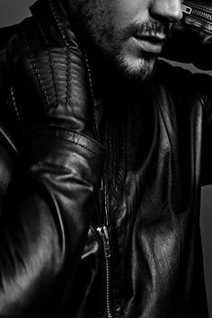 I don't know... it's the black leather, the beard, the perfect lips