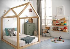 A house-framed floor bed in a Montessori-Inspired Toddler Room - Photo via RockRoseWine. Learn how to create a safe and educational Montessori bedroom or nursery for your little one using these simple tips. Big Girl Rooms, Boy Room, Kids Rooms, Child's Room, Toddler Rooms, Room Kids, Floor Bed For Toddler, Toddler Bed On Floor, Baby Floor Bed