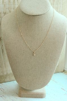 Tiny Gold Starfish Necklace-cute  Love everything beach/nautical. in particular anchors, sea turtles, beach glass, and sea stars,