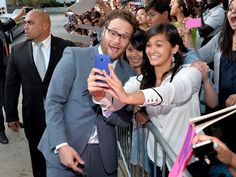 Pin for Later: 66 Celebrity Selfies That Don't Even Need a Filter  Seth Rogen stopped for a snap with fans during the LA premiere of This Is the End in June 2013.