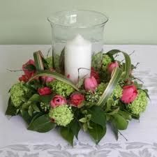 Wedding table centre with hurricane lamp (storm vase) and flowers/foliage