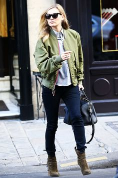 Kate Moss goes casual, but stays prim with a button-up underneath her olive-colored bomber jacket