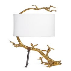 Tree of Light.Inspired by ingenious Japanese gardens, our Kyoto Table Lamp features a twisted and tortured polished brass branch lashed onto a crutch with