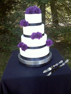 @Nikki Terrace White/black and purple wedding cake.  Simply elegant.   Leave out the black