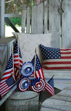 Flags in watering can on porch for a Stars and Stripes Salute | homeiswheretheboatis.net #patriotic #flag