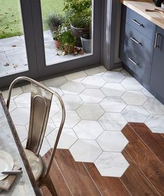 Hexagonal marble tiles meet floorboards - topps tiles Home Decor Inspiration home decor, home inspiration, furniture, lounges, decor, bedroom, decoration ideas, home furnishing, inspiring homes, decor inspiration. Modern design. Minimalist decor. White walls. Marble countertops, marble kitchen, marble table. Contemporary design. Mid-century modern design. Modern rustic. Wood accents. Subway tile. Moroccan rug.
