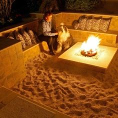 Outdoor fire pit with sand, needs different bench cushions.
