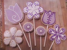 Purple flower cookies on a stick for a cookie bouquet.   Sugar and Spice Delight