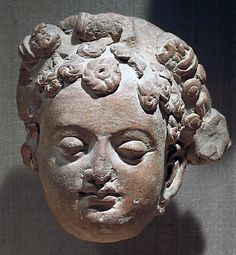 Head of a Female Figure  Date:     6th–7th century Culture:     India (Kashmir, possibly Akhnur) Medium:     Clay or terracotta