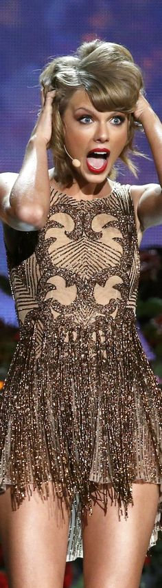 I would just like to point out people, that the bottom of this dress reminds me (and is very much like) Taylor's Sparks Fly, Mine and Story of Us dress from the Speak Now Tour!!!!