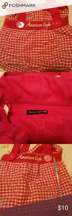 American Eagle tote bag Cute American Eagle tote bag, washable and in great condition.  Great for bringing to the beach for small things, cell phones, etc American Eagle By Payless Bags Mini Bags