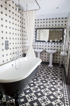 This stylish black and white bathroom is full of traditional character. From the freestanding bath, to the pedestal sink and striking floor, it shows that small Victorian bathrooms can be just as beautiful #Victorianbathrooms #smallbathrooms #bathroomsideas #traditionalbathrooms #interiors #style #ideas