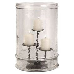 """Textured glass candleholder with three pillars.   Product: CandleholderConstruction Material: Glass and ironColor:  Silver and clearAccommodates: (3) Pillar candles - not includedDimensions: 14"""" H x 10"""" Diameter"""