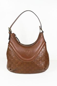 -  This authentic Gucci Small Brown (Tan) Guccissima Leather 262902 Handbag comes directly from designer boutiques  -  Small Brown (Tan) GuccissimaLeather  -  Zip top closure and double handles        -  Interior lining with pocket        -  Measurements: 11W x 8H (inch)       -  This purse comes with original cards, dust bag and Gucci tag   -  Made in Italy