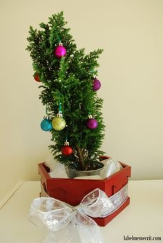 Holiday Organization: Holiday home decor featuring mini glitter tree with miniature ornaments by Label Me Merrit