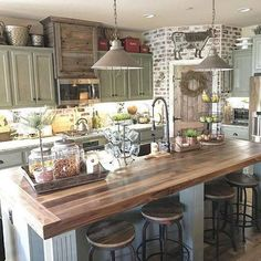 Green cabinets and wooden island