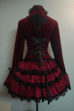 Lovely red velvet blazer with a bustle-style back and lots of red satin (?) and black lace