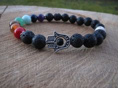 Check out this item in my Etsy shop https://www.etsy.com/listing/225146949/hamsa-bracelet-volcanic-lava-stone