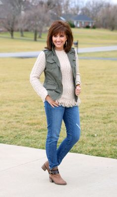 Try this cable-knit sweater and cargo vest combination for some casual weekend fashion.
