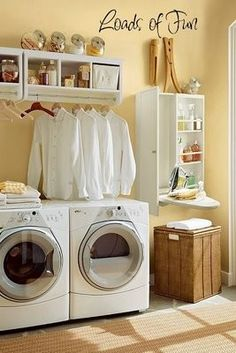 Love this laundry room. Room for decorative display on top. Storage could be altered in size. Keep stuff mostly hidden in baskets, or behind curtains. Yellow Laundry Rooms, Laundry Room Colors, Laundry Room Design, Laundry Room Decals, Laundry Room Organization, Laundry In Bathroom, Basement Laundry, Landry Room, Laundry Room Inspiration