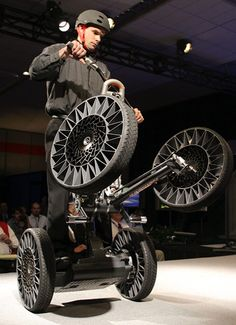 "Segway Concept - New Michelin ""Tweel"" tires are displayed on the Segway Concept…"