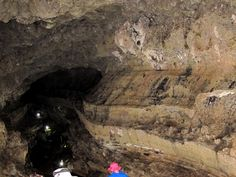Galapagos, Santa Cruz, lava tunnel. Notice the strata in the volcanic rocks.