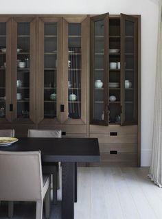 Beautiful custom built in cabinetry.  Both rustic + modern.