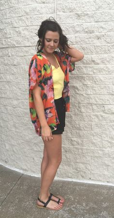 Down In The Valley. You're will not be one to shy away from a photo op while draped in this oversized chiffon cardigan. Bright colors and vibrant flowers make your confidence beam even brighter. So pretty and feminine.