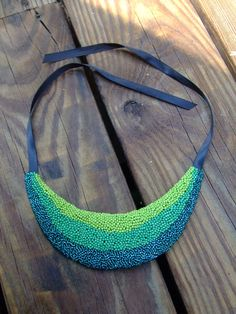 Shades of green beaded bib necklace. $25.00, via Etsy.