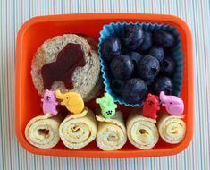 breakfast for lunch - Sliced omelet rolls, circles of toast, berries, cut shape fruit leather.