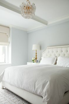 Gorgeous White And Blue Bedroom Features Walls Painted Gray Lined With A