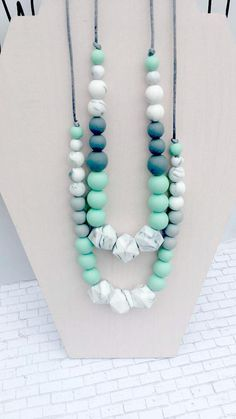 All items come with TRACKING!!!!Flat rate shipping cost. I Guarantee ALL orders!!!! Choose a DIY Kit or an a Already Made Necklace - SO Many Color options available! Looking for something just send me a message :-) First picture shown is White Mint and Dark Grey (White, Mint