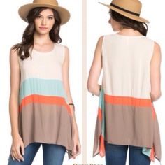 Coral sleeveless color block trapeze tank top Dress with feminine flair in this color blocked tank top. Material: 100% rayon. Available in small, medium and large. Pink Peplum Boutique Tops Tank Tops