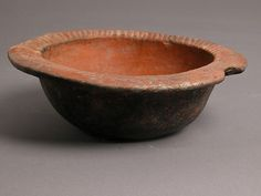 Bowl Date: 4th–7th century Geography: Made in Kharga Oasis, Byzantine Egypt Culture: Coptic Medium: Earthenware, impressed decoration Dimensions: Overall: 2 5/8 x 7 13/16 in. (6.6 x 19.8 cm)