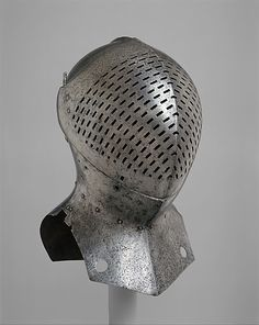 "This helm, for the tournament fought on foot, formerly hung above the tomb of Sir Giles Capel (1485–1556) in Rayne Church, Essex, as specified in his will that this, his ""beste helmett,"" and his sword be placed there. Sir Giles was part of the retinue of Henry VIII that challenged all comers during the tournaments held at the Field of Cloth of Gold, the famous summit meeting between England and France at Calais in 1520. He may have worn this helm on that occasion."