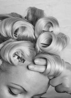 Voluminous Blowouts and Retro Pin Curls: easy way to curl hair with damp hair wrap hair like so and pin then blow dry or sleep in it