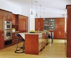 Sleek Cherry Cabinets  I like the idea of incorporating a china cabinet area into the kitchen cupboards.