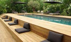 If you are fortunate enough to have a swimming pool in your backyard, you will want to maximize the design of that space with a cozy pool seating area. You may have a lot of space available near your pool… Continue Reading → Above Ground Pool Landscaping, Above Ground Pool Decks, Backyard Pool Landscaping, Above Ground Swimming Pools, Swimming Pools Backyard, Swimming Pool Designs, Modern Landscaping, In Ground Pools, Landscaping Ideas