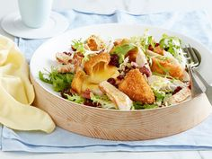 This is salad, but not as you know it. Here, we've paired the unbeatable combination of turkey and cranberries with crispy fried brie for a super indulgent dish that'll make you stoked to eat salad every day.
