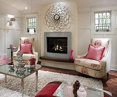 i really like this room, the fabric on those chairs, I dont think I would ever get tried of..