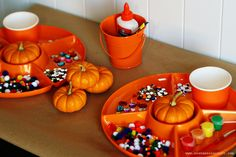MOM HACK: Use a dollar store divided tray for easy miniature pumpkin painting for kids.