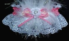 Fashion forward. The 'Feature' Prom Garter is available in 175 colors of satin band and trim to match your Prom dress. The accent is opalescent Marabou feathers and floating pearls. You can personalized this Prom Garter with imprinted ribbon tails, engraved heart charm, or several 'teen charms' to choose from. Visit: www.garters.com/page37a.htm