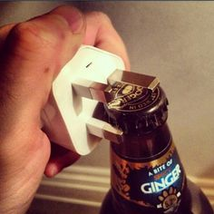 Learn the sacred truth that you can open a beer with anything, like a plug. | 30 Brilliant Ways To Hack Your Booze