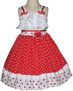 Girls polka dot dress with white ruffles across the chest, perfect for a Disney vacations and visit Minnie Mouse!