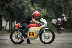Custom Honda Tiger by Rich Richie Garage, a tribute to the iconic RC166 racer.
