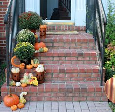 front step ideas. love the brick and dark railings