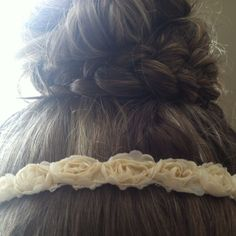 Combining two of my favorite current hairstyles, the top knot and the braid.
