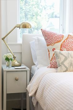 The prettiest summer house style bedroom by Braun + Adams with a clever Ikea hack - the nightstand is an Ikea piece updated with a brass knob and painted in Palladian Blue from Benjamin Moore